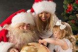 child receiving gift from santa claus