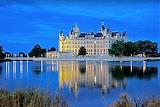 Night lights of Schwerin Castle reflected in lake