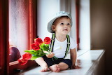 beautiful child with bouquet of flowers