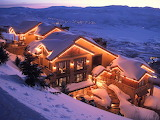 Snowy mountain cabin at twighlight