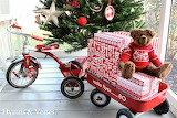 ^ Christmas red wagon, tricycle, presents and bear