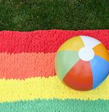 Colorful beach ball & blanket