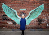 ^ Camilla Grows Wings street art by Paul Curtis