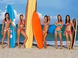 Surf-boards-girls-surfing-ocean-sports-woman-swim suit