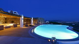 Beautiful rural stone villa and pool at night in Mykonos