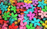 Rainbow colors of wood flower buttons