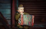 Boy, accordion, soldier, son of the regiment