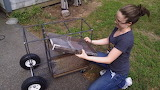 Girl making a cart for the welding machine