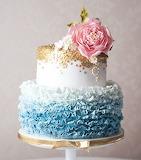 Blue ruffled ombre wedding cake