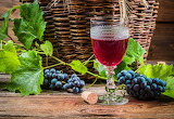 Wine, grapes, leaves, glass
