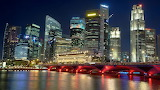 Malaysia-Singapore-City-at-night-river-bridge-building-skyscrape