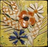 Fleurs et épis de blé en céramique à Orléans (Loiret)