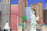 colorful buildings and statue of liberty