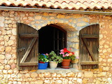 ^ Window shutters and flowers, France