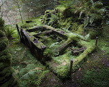 An ancient mine winding machine in the woods- Corris