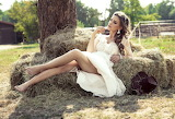 Girl sitting on hay