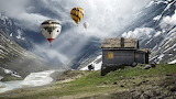 Father-and-son-hot-air-balloons-wooden-hut-mountain