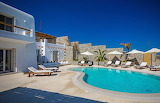 Modern white and stone Greek villa and pool