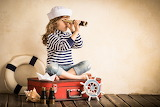 Girl, spyglasses, binoculars, suitcase, paper ship, sea shell, w