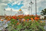 Basilica-golden domes-lampposts-flower beds-sky-clouds-Mosk