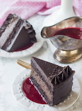 Chocolate cheesecake cake with raspberry sauce