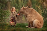 little girl feeding bear
