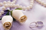 Roses, wedding rings and pearls