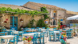 Trattoria, tables, chairs, flowers, outdoors, sicily