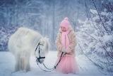 Little-girl-pink-scarf-headset-pony-animal-snow-winter
