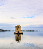15th century mill in lagoon Orbetello Italy