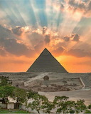 Sunset over Giza Pyramids seen from Cairo