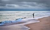 Surf fishing before sunrise