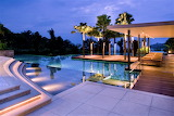 Luxury contemporary pool and terrace at sunset