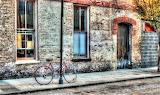 Bike against pole and brickwall ...