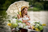 girl on a boat filled with flowers