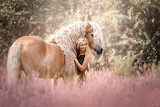 Blond horse and girl