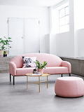 Soft pink sofa with gold coffee table