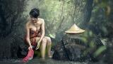 Asian woman, water, rock, trees, hat 3-desktop