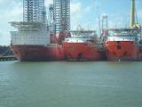 Galveston ship channel, oil rigs.