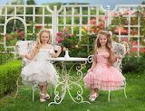 Girls, children, garden, gate, flowers, table, bush, trees, gras