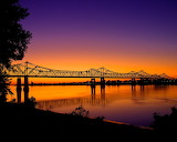 Sunset at a bridge over the Mississippi River Natchez