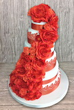 Red roses and lace wedding cake