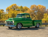 Old pickup truck of green color