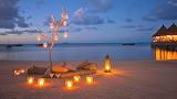 Maldives beach scene at sunset