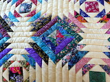 ^ Pineapple Log Cabin Amish Quilt