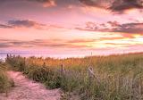 Sunrise on a beach path at Cape Cod