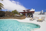 Modern white villa, garden and pool in Lanzarote