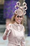 Princess beatrice famous hat enormous taupe O with a bow on top