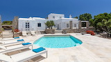 Pretty white Greek island villa and pool