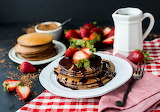 chocolate coverd pancakes with strawberries